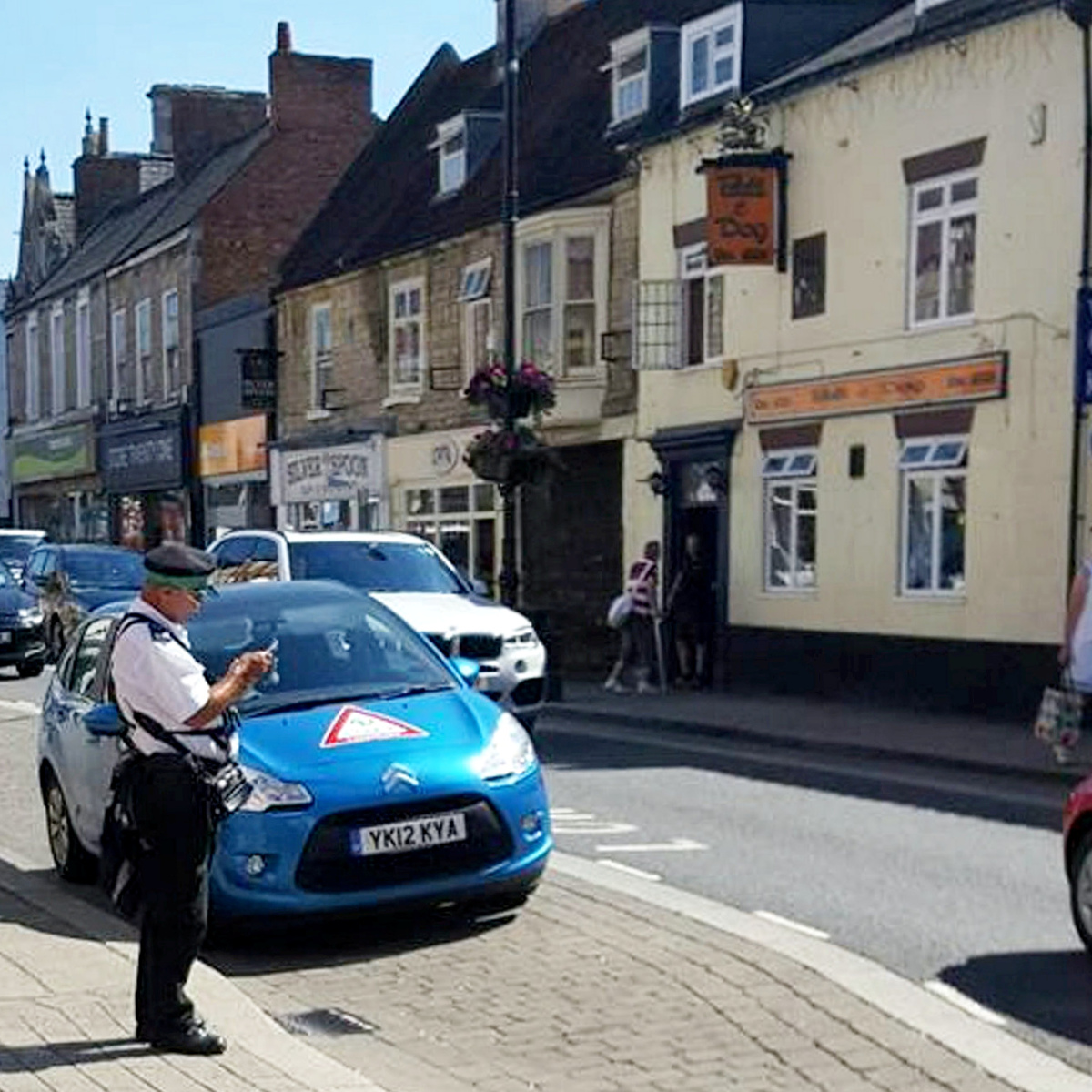 """Photos that appear to show a traffic warden attempting to ticket a LIVES first responder's car has sparked outrage on social media. See NTI story NTIWARDEN. The warden was about to ticket the car in the centre of Sleaford on Tuesday while the first responder was trying to save the life of an 82-year-old man who had suffered a heart attack. LIVES medics and responders are volunteers who give up their time to respond to medical emergencies throughout Lincolnshire. They are often first on the scene of an accident or emergency. But they are required to abide by the Highway Code at all times during their work. Despite this, Sleaford resident Anthony Woods, 49, who witnessed the incident, said the warden needed to """"hang his head in shame"""". Luckily the driver turned up before he could book her."""